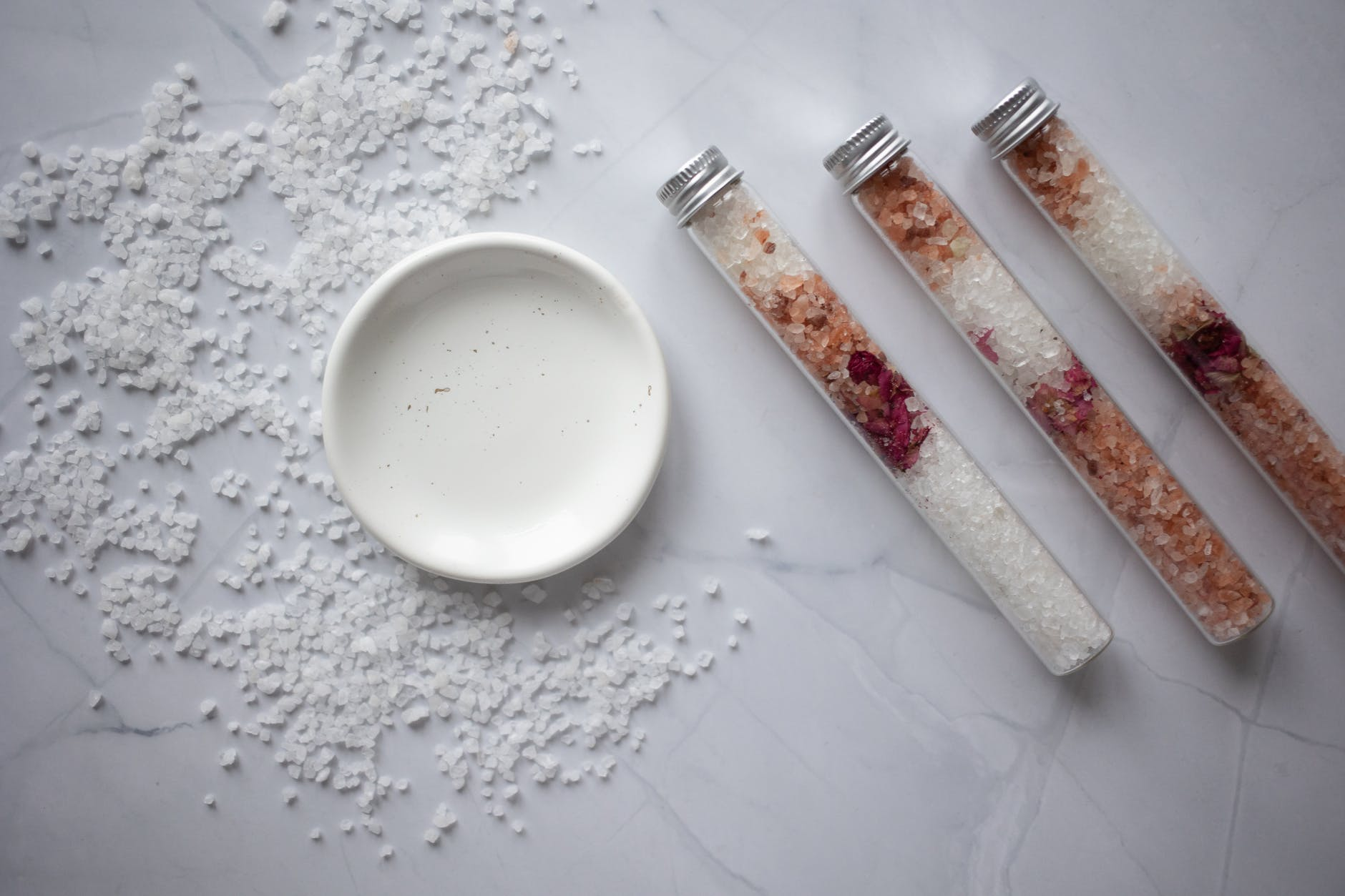 set of salt for bath placed on marble table