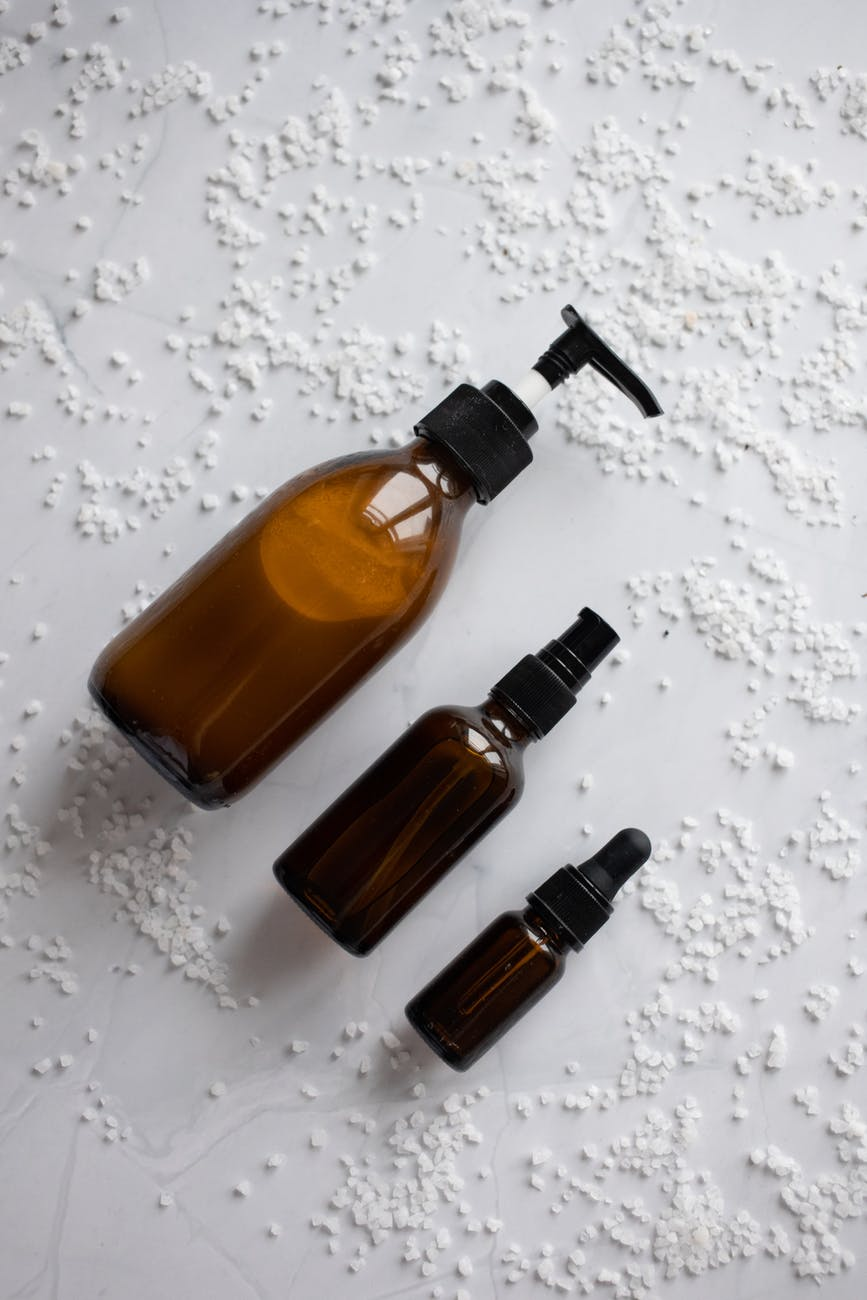 set of skincare products placed on white table