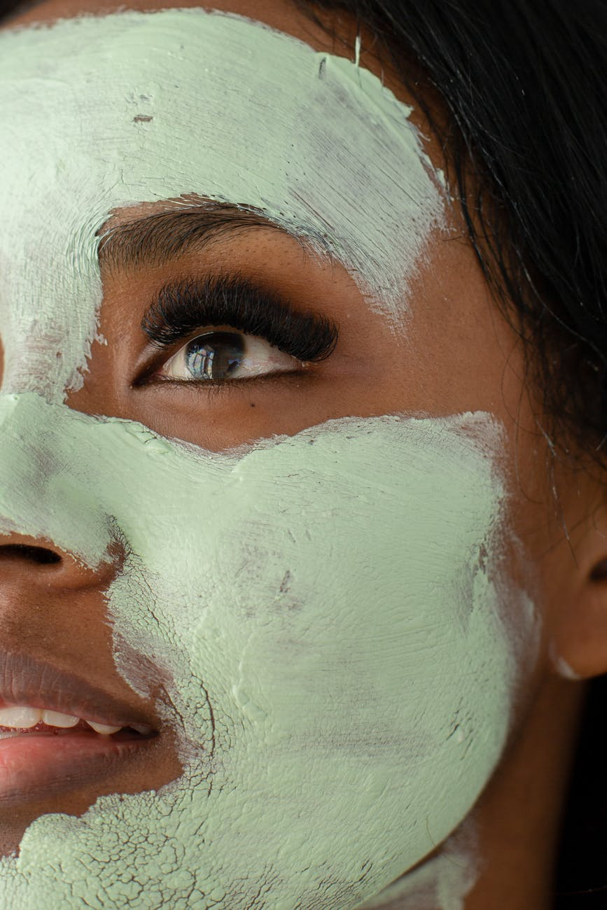 anonymous black woman with clay mask